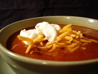 A close up view of keto crockpot chili topped with sour cream.
